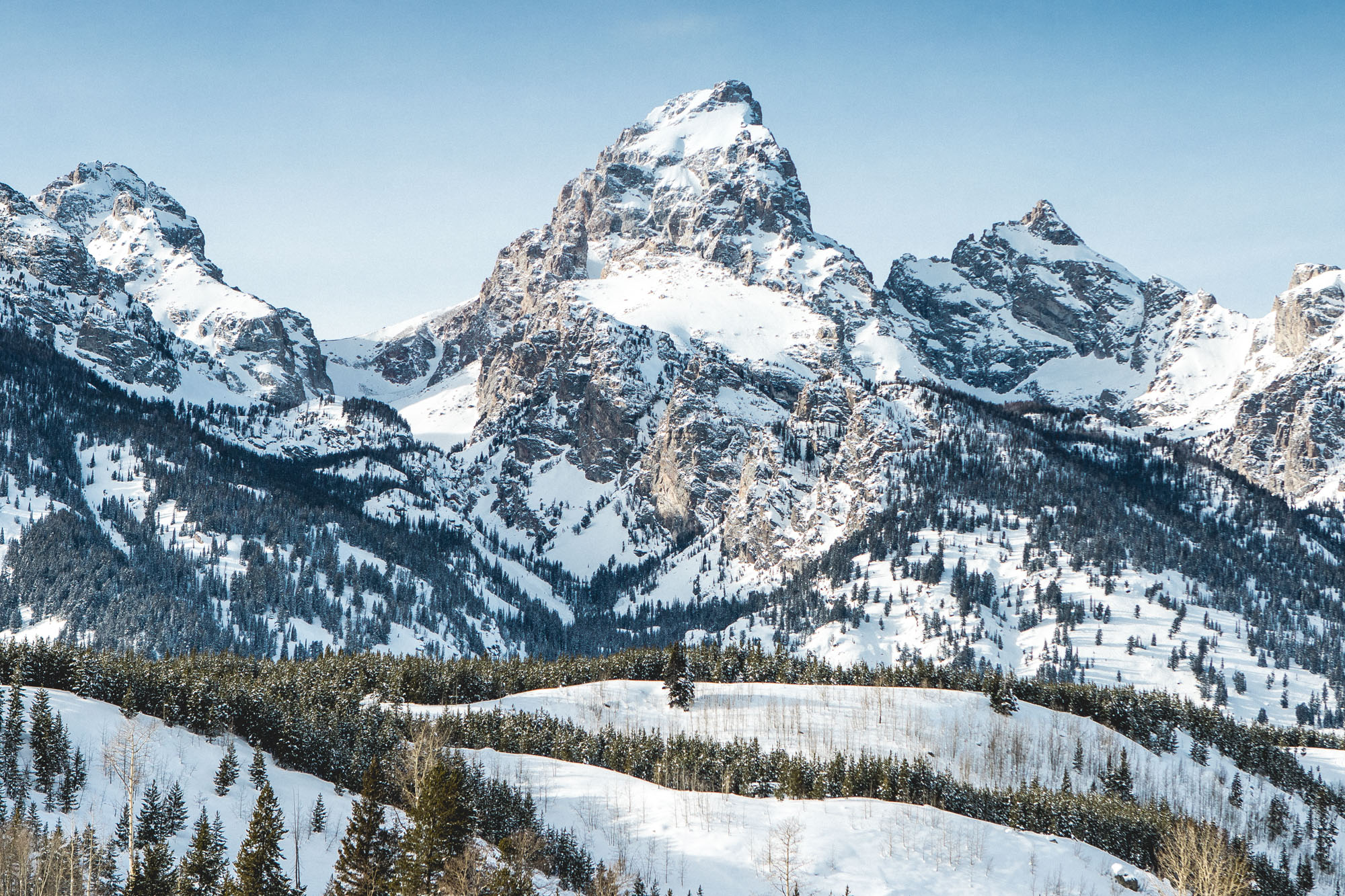 Grand Tetons with snow and blue skies