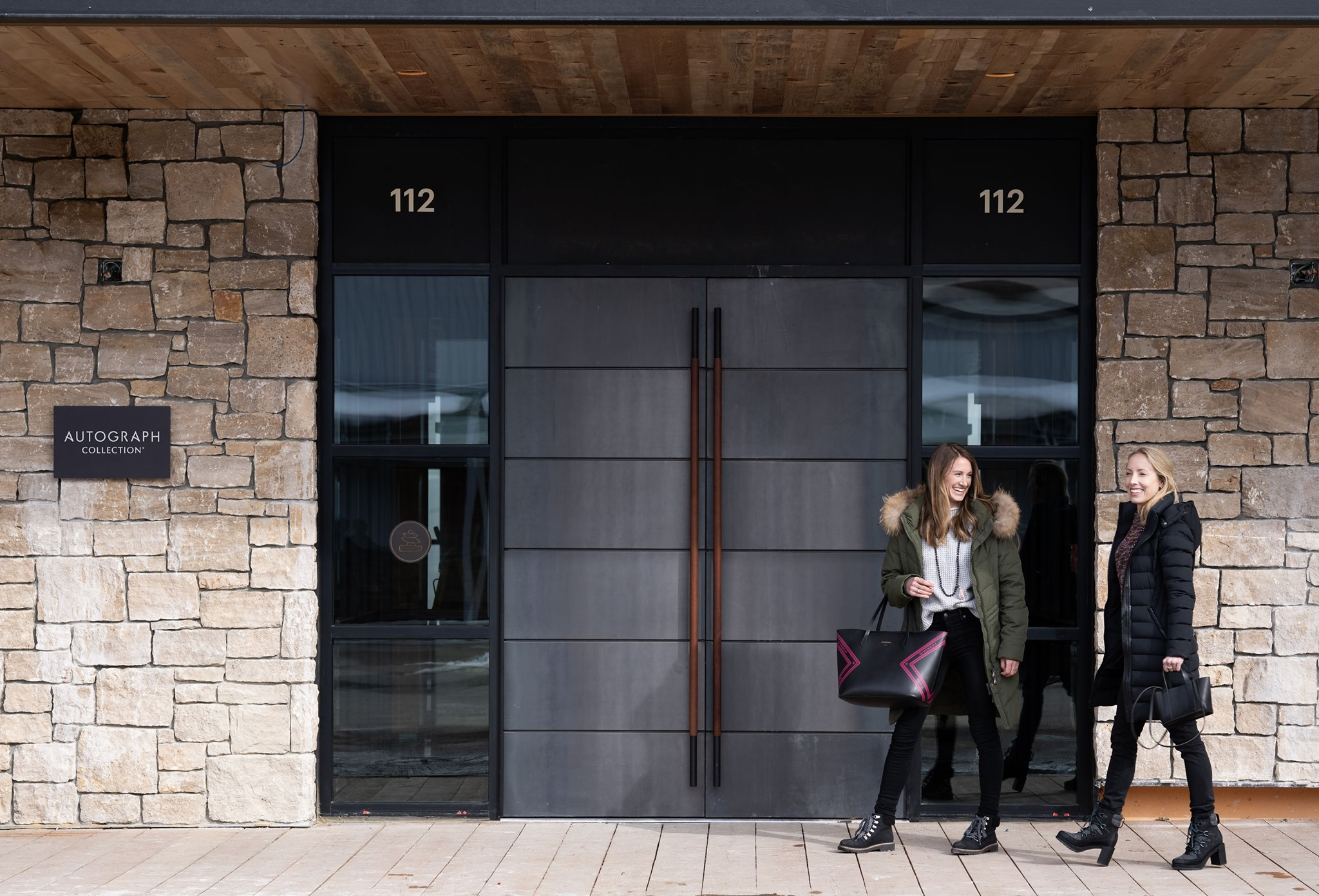 Women pass in front of The Cloudveil Hotel in Jackson Hole Wyoming