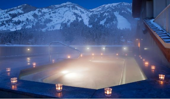 Teton Mountain Lodge Rooftop Hot tub at night with candles