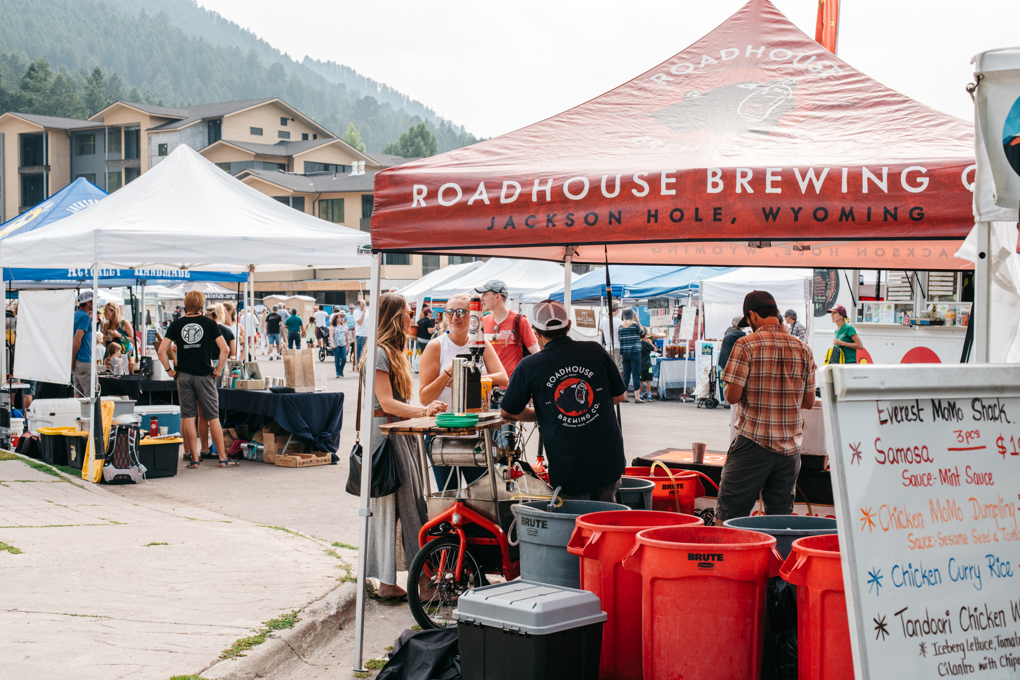 Jackson Hole Wyoming's People's Farmer's Market at the base of Snow King Mountain with beer and food stands