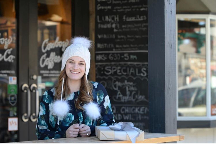 Andi Dornan outside of Jackson Hole Wyoming's Cowboy Coffee on the Elk Antler Town Square